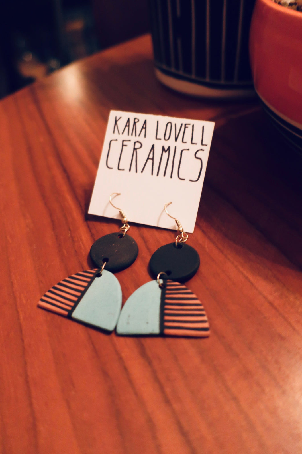 Red clay earrings with black and turquoise