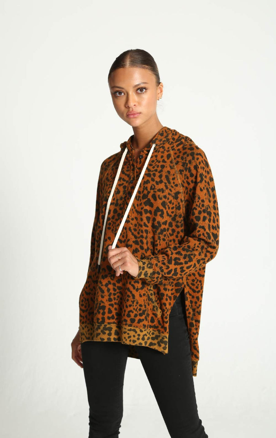 fixxation boutique, domino hoodie sweatershirt, leopard print, button detailing, side slits, white drawstrings, sarasota
