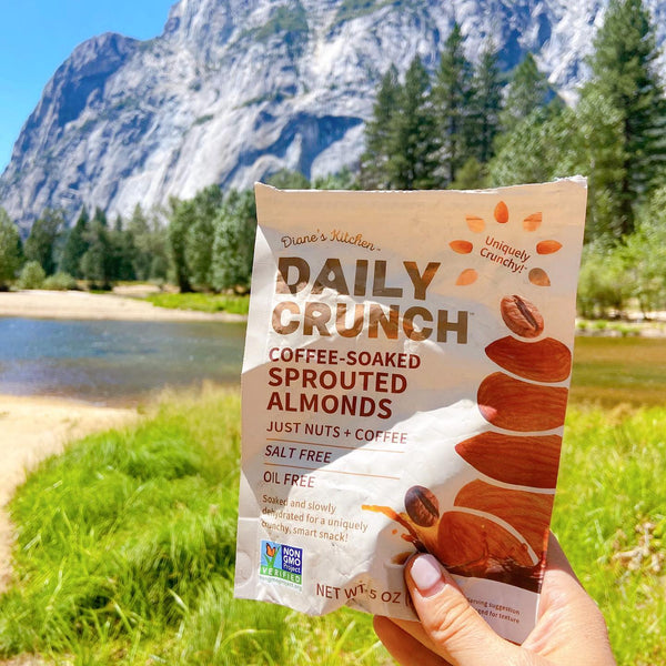 Daily Crunch Almonds Bag Over Scenic Mountain Landscape