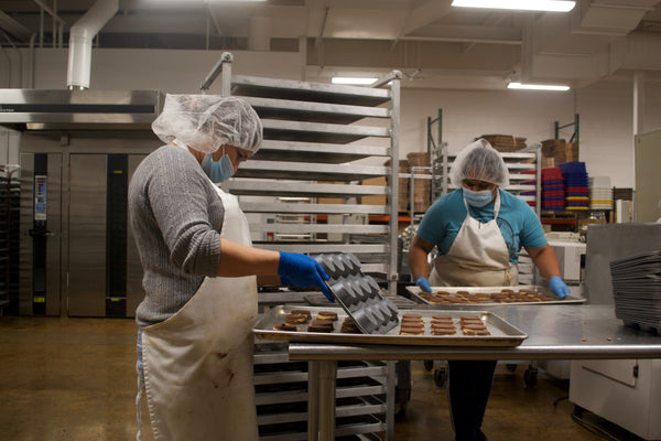 Workers with Muffin Tins at Colts