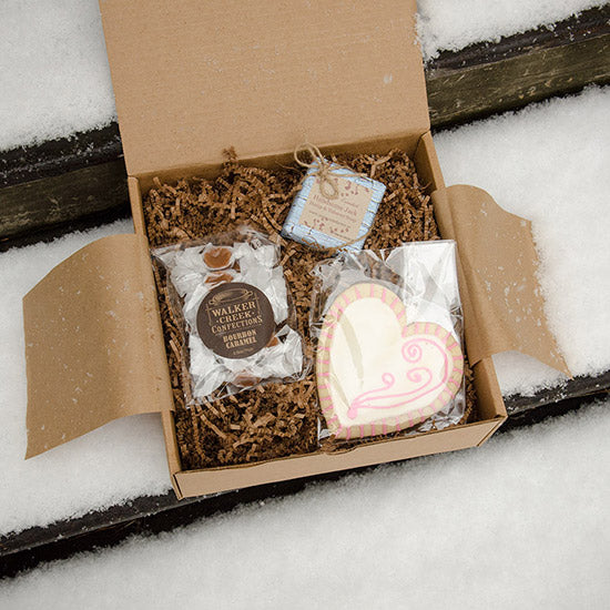 Be Mine Batch Box  A little sugar—Walker Creek Bourbon Caramels and an iced cookie from Cynthia—plus a handcrafted bar of hemp and tobacco soap from Sunnyside Farms.