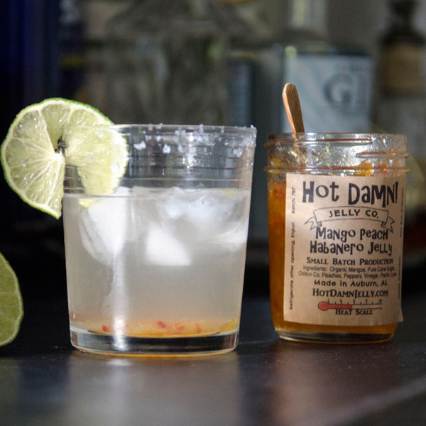 Hot Damn Mango Peach Habanero Jelly makes for a sweet and spicy margarita.