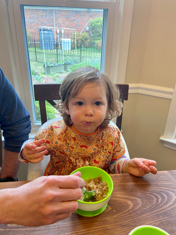 toddler eating Southern City Flavors cobbler from Batch