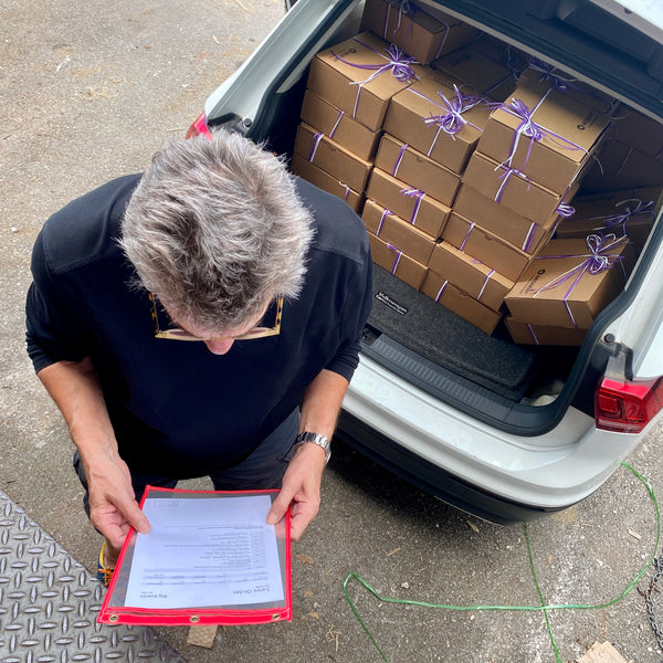 Car Packed with Boxes with Dutch Man Reading Sales Order