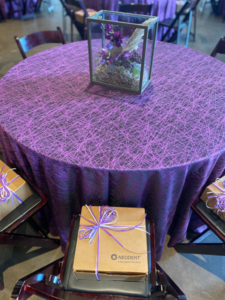 Neodent Corporate Event Gift On Chair in Front of Flowers
