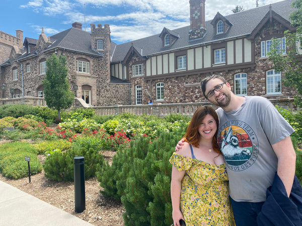 Engaged couple with Highlands Ranch Mansion
