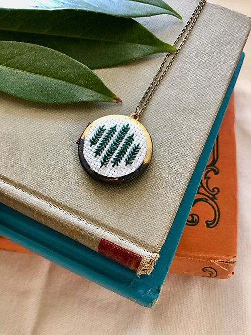 Pearl & Swirls green cross-stitch locket necklace from Batch for an alternative St. Patrick's Day green gift
