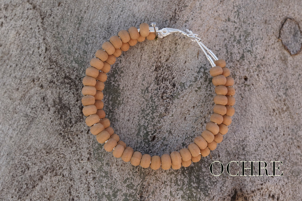 A. Natural Dyed Wooden Beaded Hoop earrings