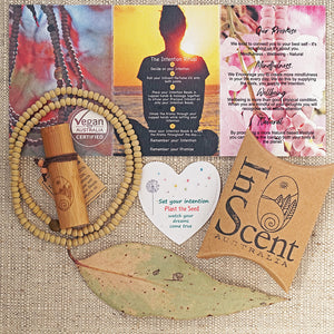 Intention Kit contains 1x Botanical Vegan Perfume oil, One strand Hand dyed wooden Beads, One Seed Card, One Intention Ritual Instruction