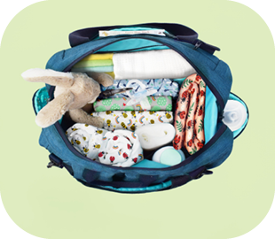 Bambino Mio baby changing bag filled with out and about items