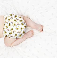 Baby crawling wearing a reusable nappy