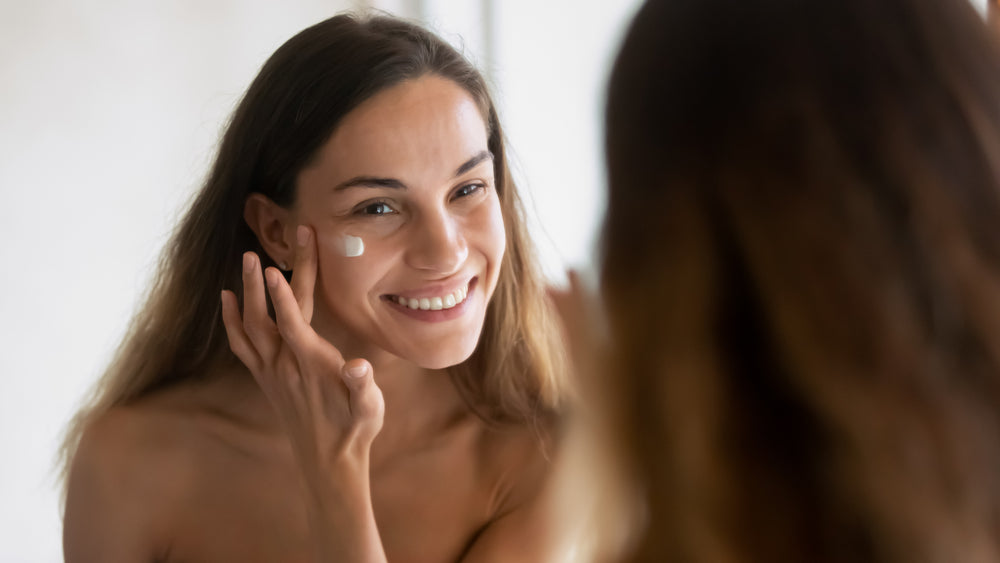 Woman Applying Hydration Cream to Face