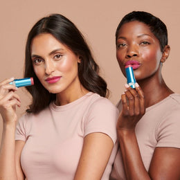 Models wearing the Berry shade of Sunforgettable® Total Protection™ Color Balms SPF 50