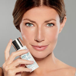 Woman holding Pep Up® Collagen Renewal Face & Neck Treatment