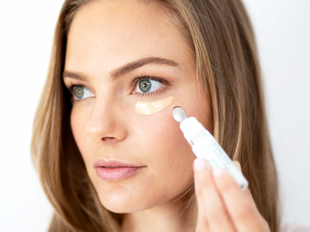 Woman applying Total Eye 3-in-1 Renewal Therapy SPF 35 || all