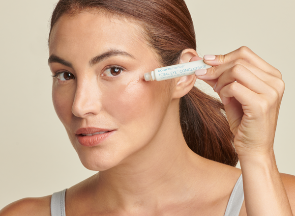 woman applying total eye CONCENTRATE