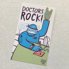 'Doctors Rock' Ribbon Enamel Pin by PBK