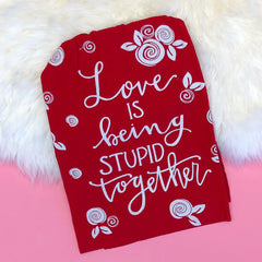 'Love Is Being Stupid Together' Kitchen Towel by PBK