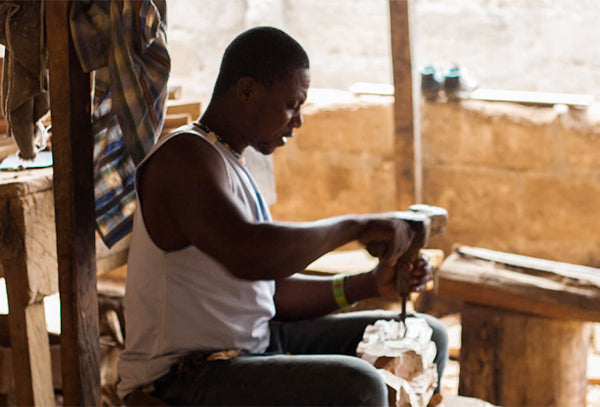 Ghanaian artisan carves furniture from wood