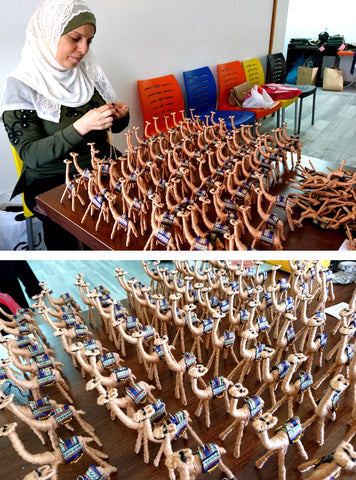 Image shows an artisan crafting Proud Camel ornaments.
