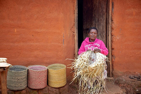 Tanzanian woman artisan, weaving Maila baskets