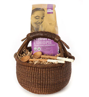Brown bolga gift basket with coffee and 2 handcarved wooden spoons