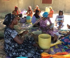 Wolof women weavers, communal weaving outside, Senegal