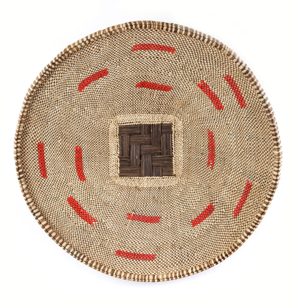This beautiful finished Choma basket is woven from palm fronds and red recycled, single use plastic bags.