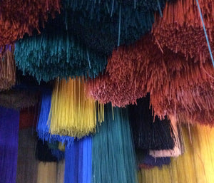 Plastic strips used for Senegal hampers, upcycled from a local prayer mat factory