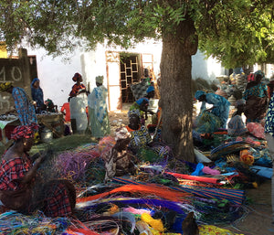 Weavers working under the shade of a tree in Senegal