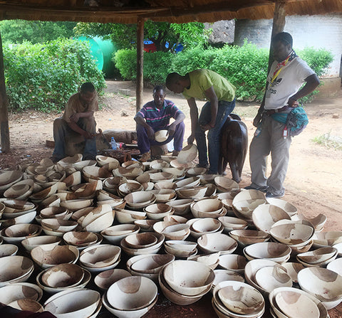 Zambian wood carvers in their workshop, and many handcarved bowls