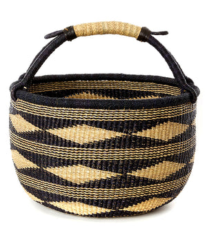 Contrasting black and natural diamond design on a bolga basket, handwoven in Ghana,