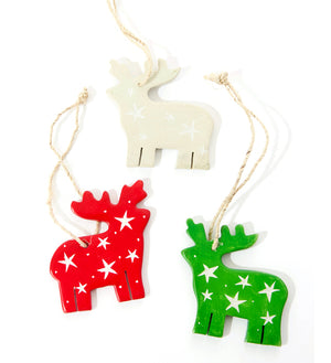 Set of three hand-carved soapstone reindeer Christmas tree ornaments in red, green and natural. Handmade in Africa.