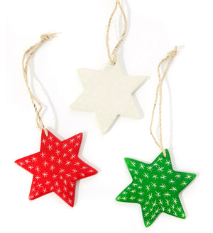 Set of three hand-carved soapstone star Christmas tree ornaments in red, green and natural. Handmade in Africa.