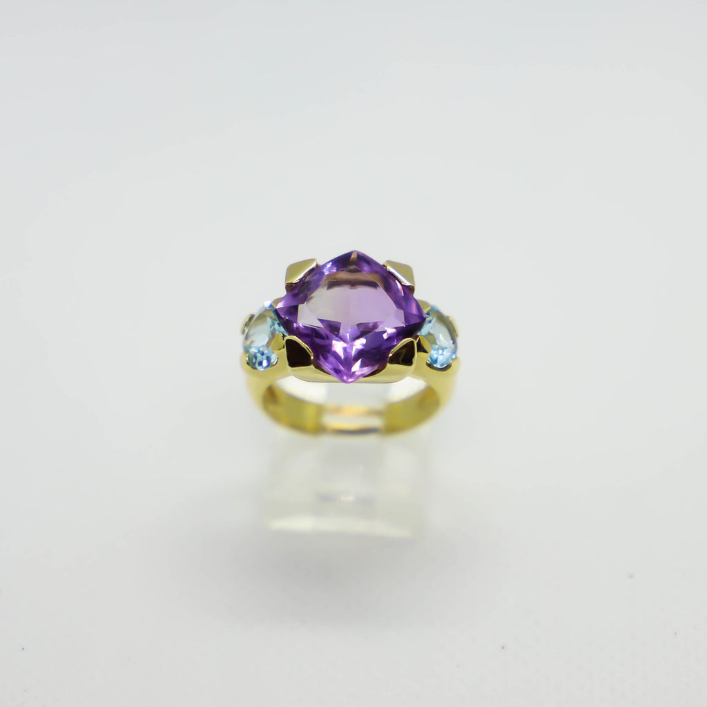 Yellow gold amethyst and blue topaz ring