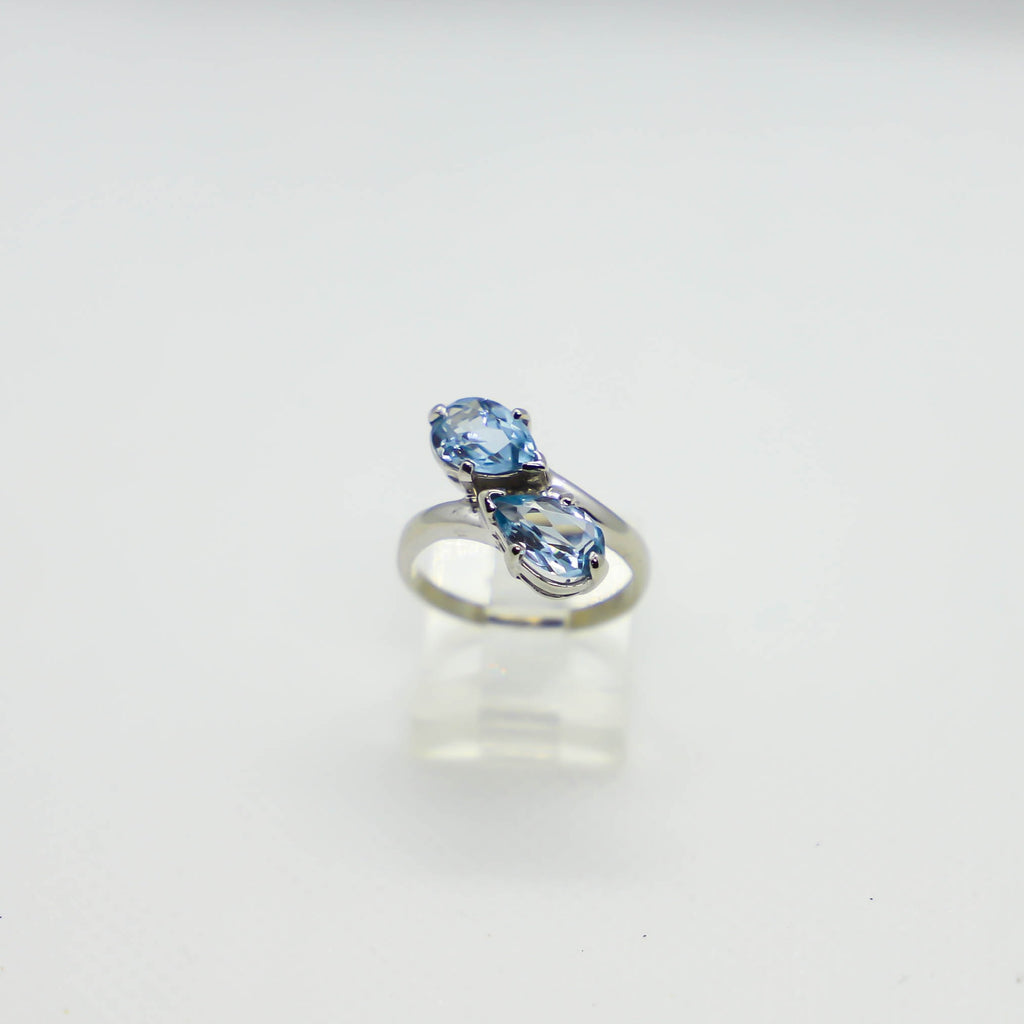White gold, pear shaped blue topaz ring