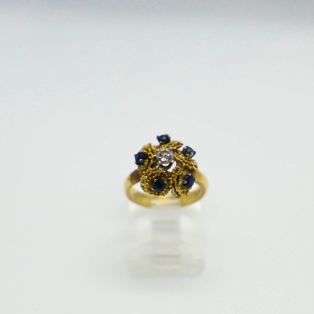 Yellow gold sapphire and diamond cluster ring