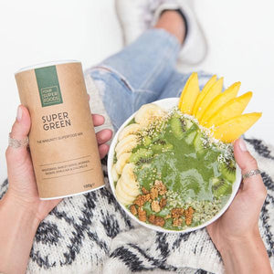 lady holding bowl of breakfast bowl with your superfoods super green