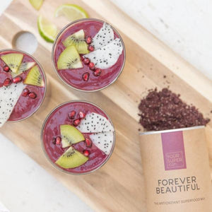 your superfoods forever beautiful smoothie in mason jars, recipe with dragon fruit, kiwi and pomegranate