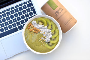 breakfast bowl of your superfoods power matcha sitting on macbook pro keyboard