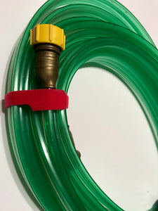 grap double sided hook and loop grapped around a garden hose