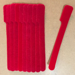 10 pieces of short  red grap is pictured. grap is double-sided hook and loop used to craft, organize, and problem-solve in the home, garage, rv, boat, and craft room! choose color yellow, blue, green, red and black