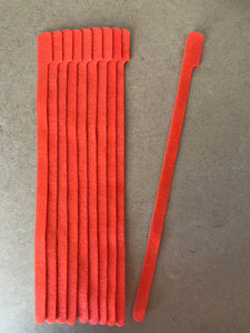 10 pieces of X-Long orange grap is pictured. grap is double-sided hook and loop used to craft, organize, and problem-solve in the home, garage, rv, boat, and craft room! choose color yellow, blue, orange, green, red and black