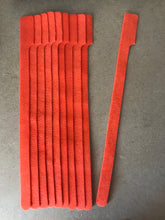 Load image into Gallery viewer, 10 pieces of XX-Long orange grap is pictured. grap is double-sided hook and loop used to craft, organize, and problem-solve in the home, garage, rv, boat, and craft room! choose color yellow, blue, orange, green, red and black