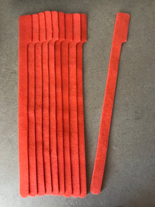 10 pieces of XX-Long orange grap is pictured. grap is double-sided hook and loop used to craft, organize, and problem-solve in the home, garage, rv, boat, and craft room! choose color yellow, blue, orange, green, red and black