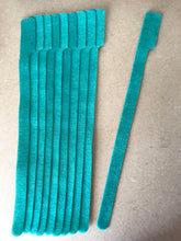 Load image into Gallery viewer, 10 pieces of XX-Long green grap is pictured. grap is double-sided hook and loop used to craft, organize, and problem-solve in the home, garage, rv, boat, and craft room! choose color yellow, blue, orange, green, red and black