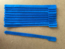 Load image into Gallery viewer, 10 pieces of long blue grap is pictured. Grap is double-sided hook and loop used to craft, organize, and problem-solve in the home, garage, rv, boat, and craft room! choose color yellow, blue, orange, green, red and black
