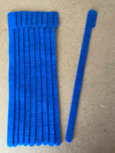 Load image into Gallery viewer, 10 pieces of XL blue grap is pictured. grap is double-sided hook and loop used to craft, organize, and problem-solve in the home, garage, rv, boat, and craft room! choose color yellow, blue, orange, green, red and black