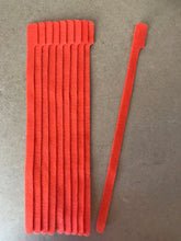 Load image into Gallery viewer, 10 pieces of X-Long orange grap is pictured. grap is double-sided hook and loop used to craft, organize, and problem-solve in the home, garage, rv, boat, and craft room! choose color yellow, blue, orange, green, red and black