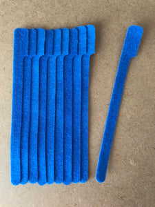 10 pieces of medium blue grap is pictured. grap is double-sided hook and loop used to craft, organize, and problem-solve in the home, garage, rv, boat, and craft room! choose color yellow, blue, orange, green, red and black